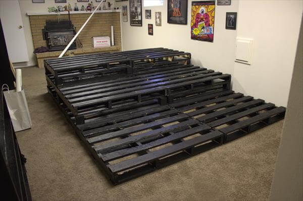 Diy pallet home theater 99 pallets - How to build a garage cheaply steps ...