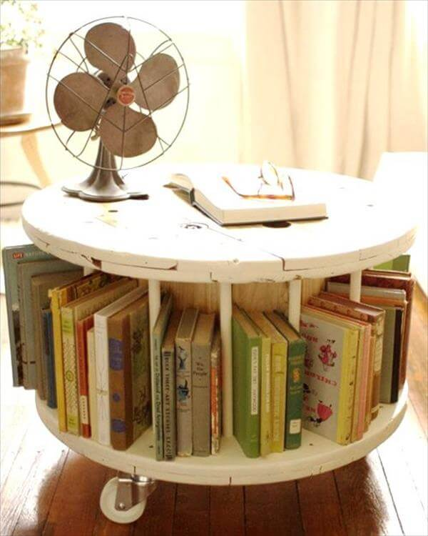 salvaged cable drum table with book storage