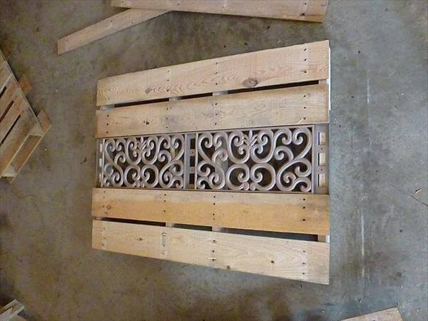 adding the metal pieces to pallet