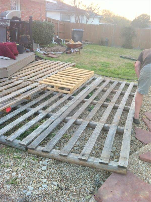 Diy pallet deck home exterior improvements 99 pallets for Decking made from pallets