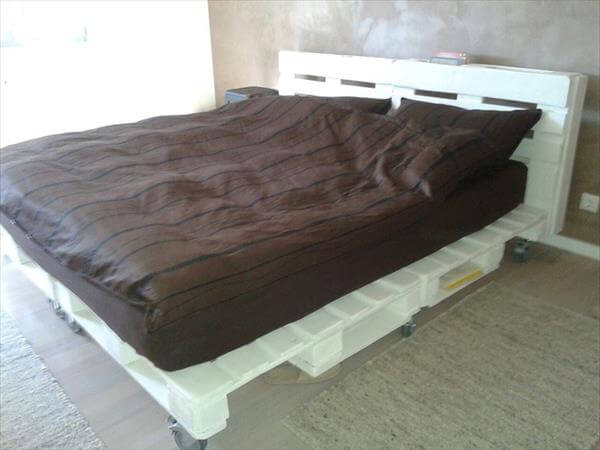 recycled pallet bed with nightstand