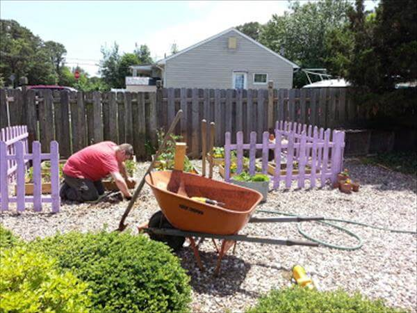 cleaning the area for pallet garden picket fence