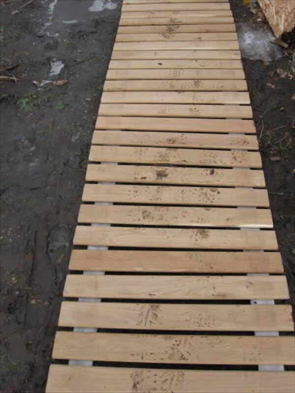 salvaged pallet and fire hose walkway
