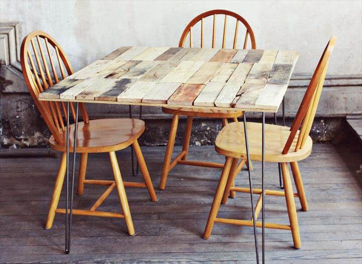 reconstructed pallet dining table with metal legs
