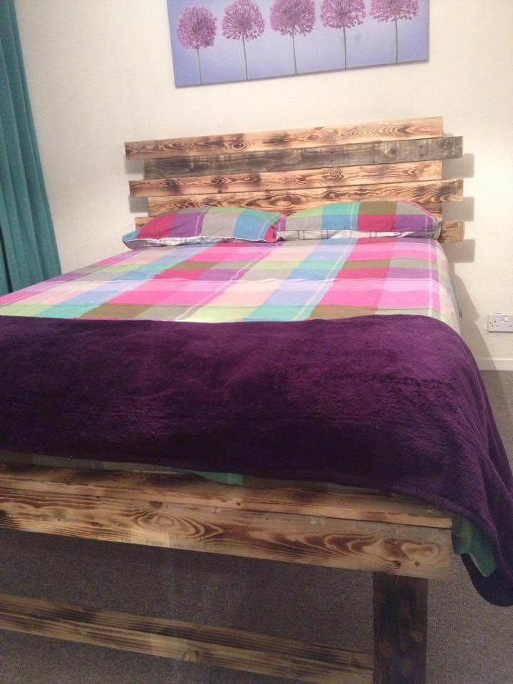 rustic yet modern pallet bed with headboard