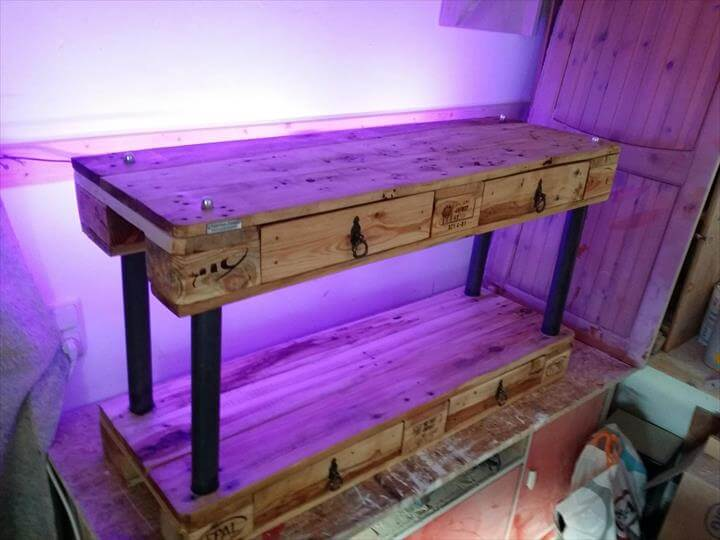 recycled pallet and metal pipe tv stand