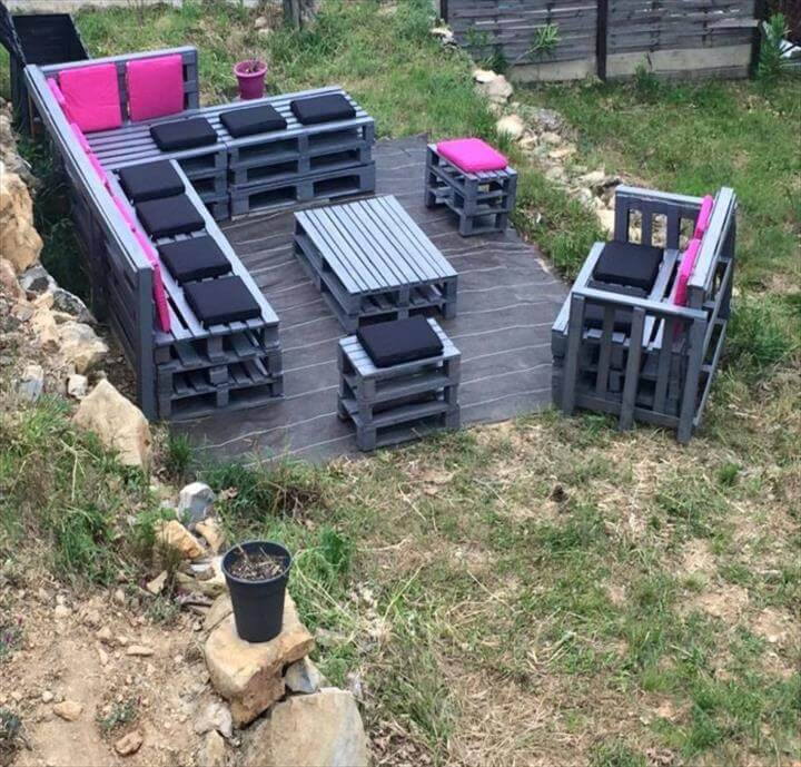 stacked pallet L-sofa with tables and benches