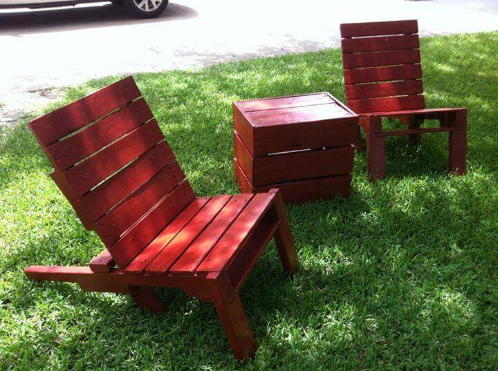 recycled pallet red stained lounge chairs