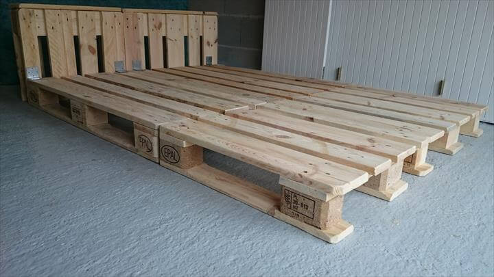 Use whole pallets to get a sturdy bed frame as long as you want to fit ...