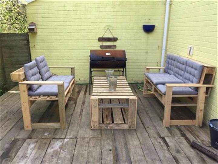 reclaimed pallet table and cushioned benches
