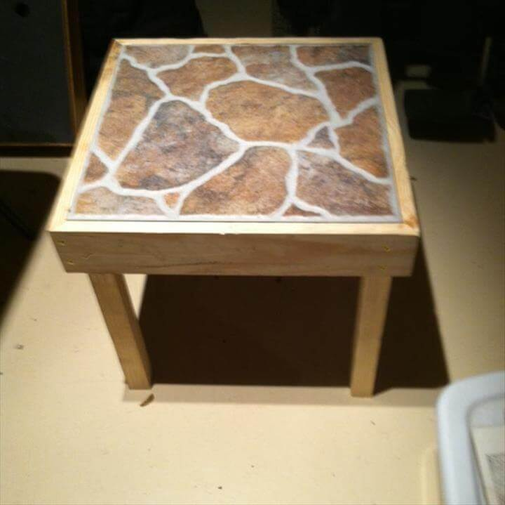 Recycled pallet stool with ceramic tiles
