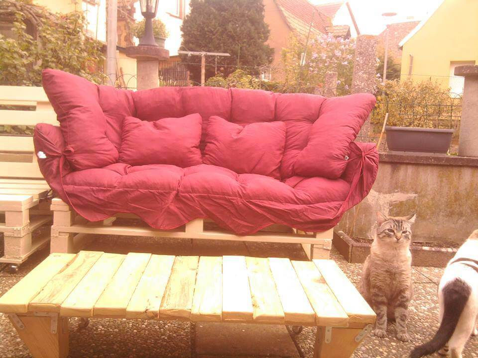 handmade wooden pallet sofa with red cushion