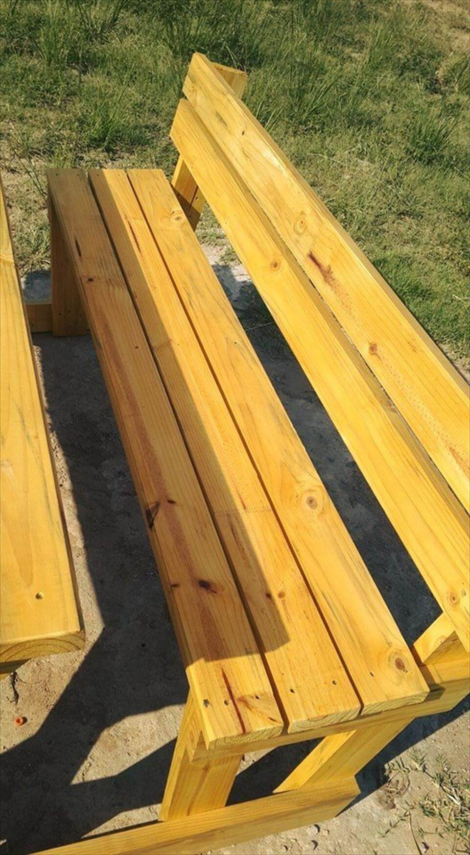 Yellow stained pallet picnic table with benches