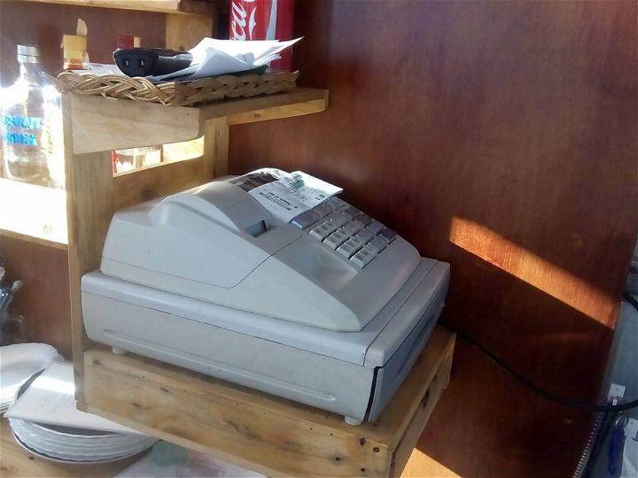 Reclaimed pallet cash register holder