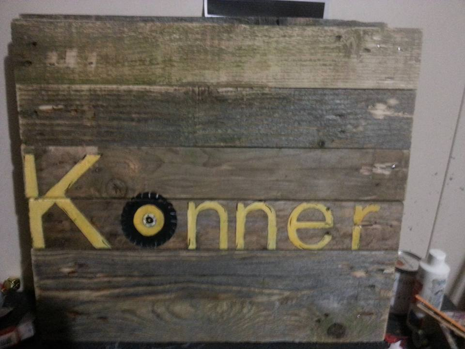 handmade pallet art with stenciled name