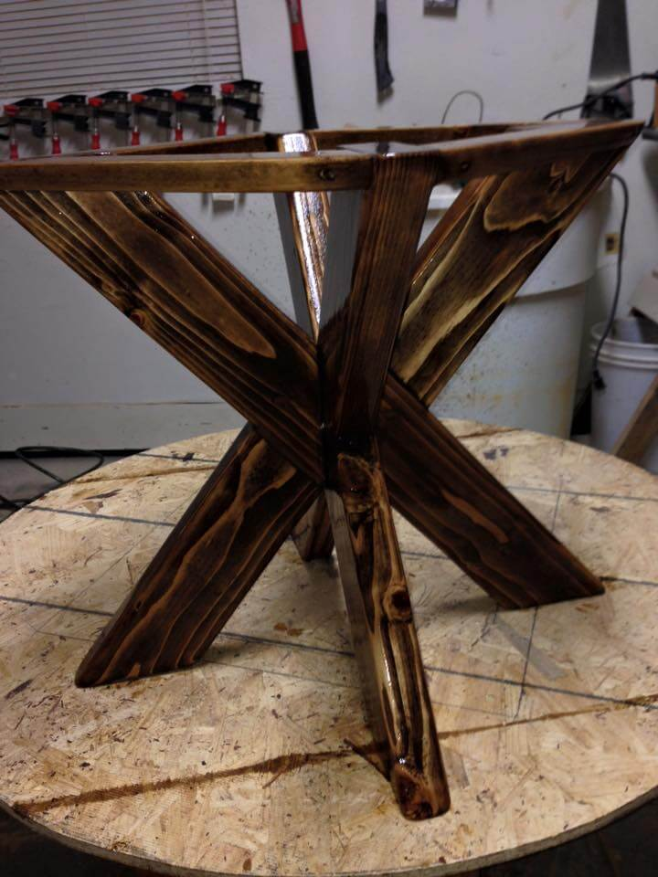 Wooden pallet dining table with X base