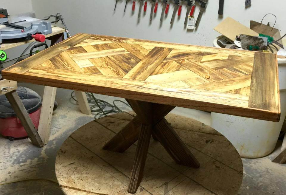Repurposed pallet dining table with X base