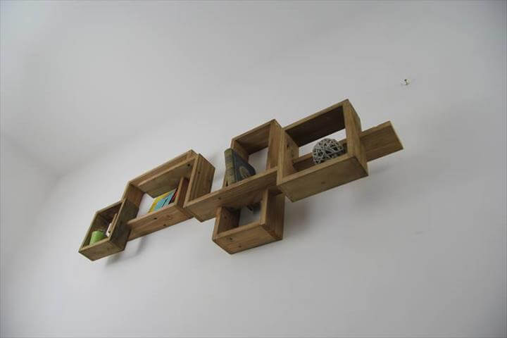 low-cost wooden pallet art style shelves