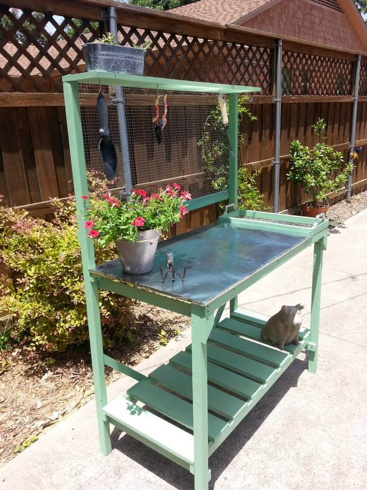 recycled pallet potting bench with galvanized zinc top