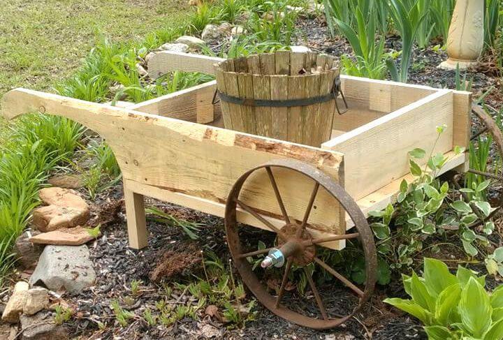 wooden pallet and old cart wheel wheelbarrow