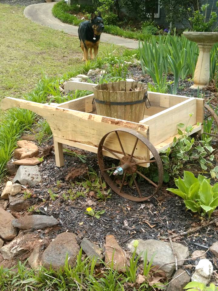 wooden pallet and old cart wheel wheelbarrow