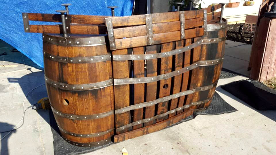 handcrafted wooden pallet and old barrel