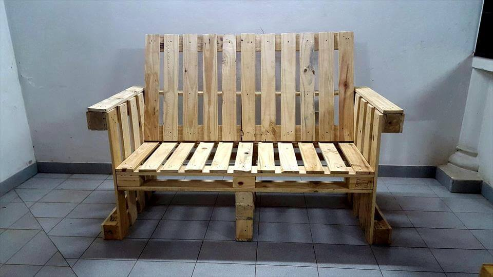 Wooden pallet bench with arms
