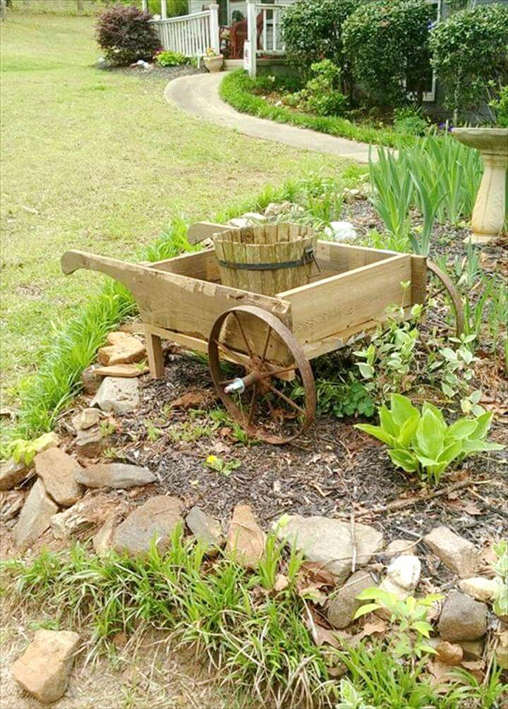 handcrafted wooden pallet and old cart wheels wheelbarrow