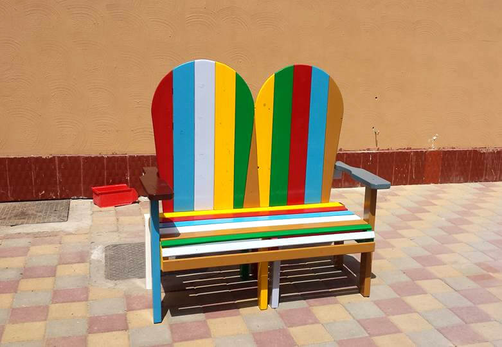 rainbow pallet Adirondack style bench