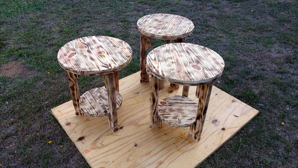 antique wooden pallet scorched round tables