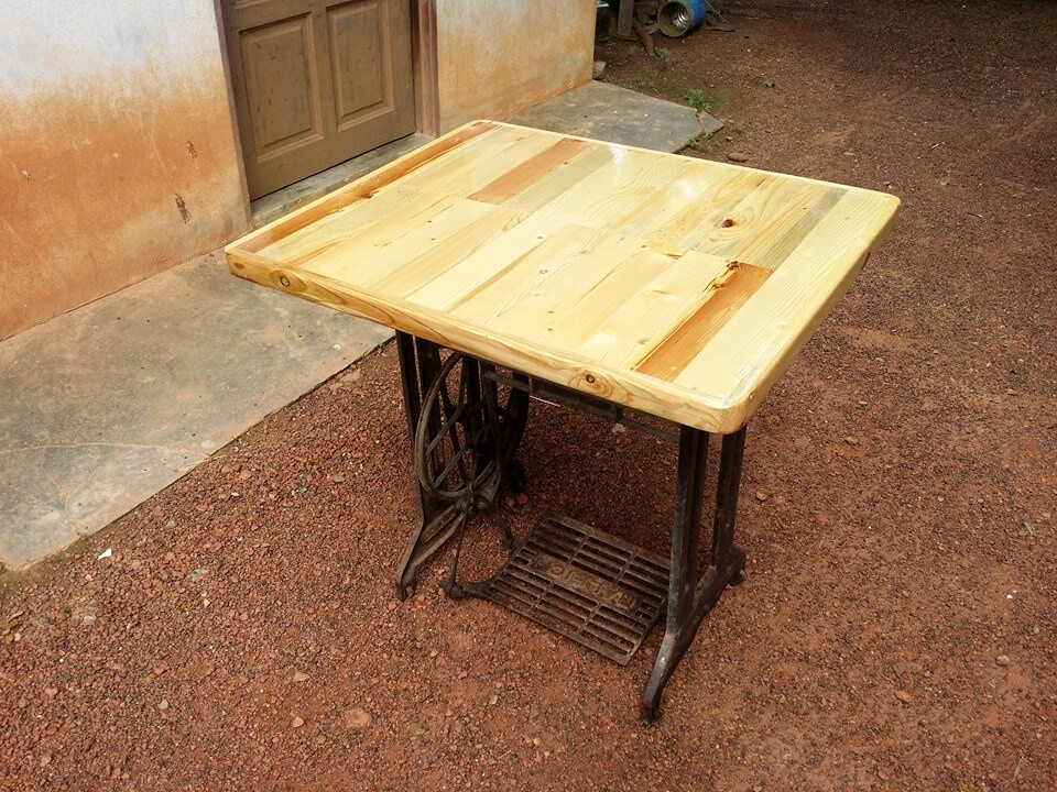 handcrafted pallet and old sewing machine base table