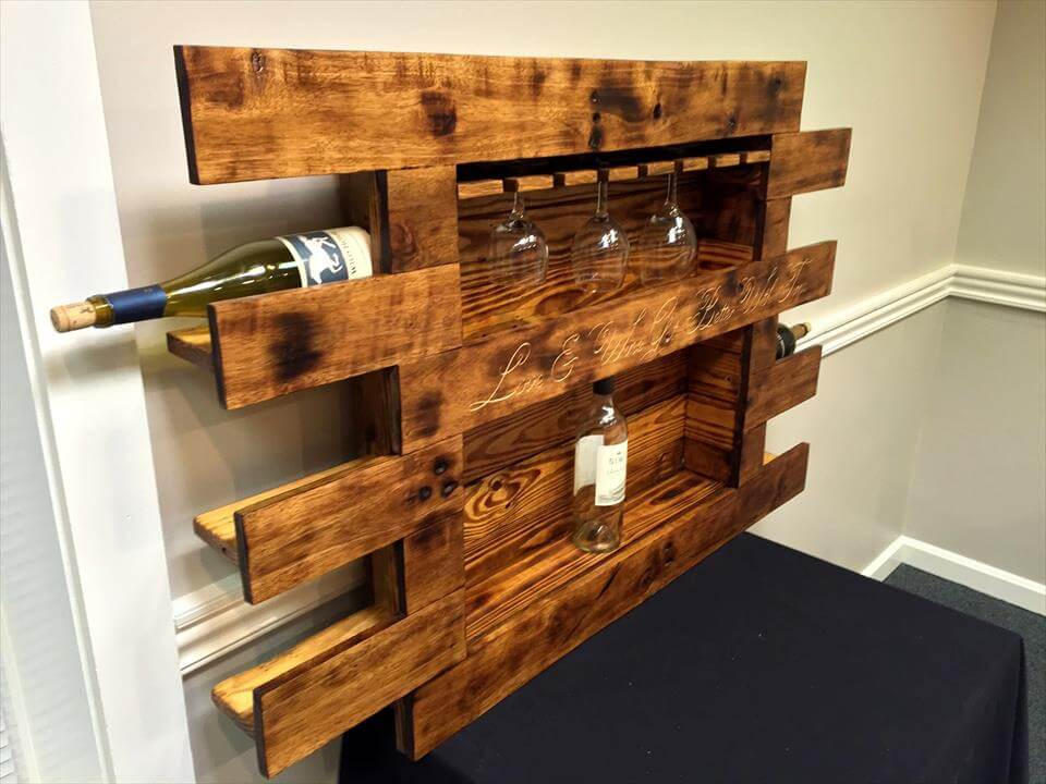 repurposed wooden pallet beverage bottle and glass rack