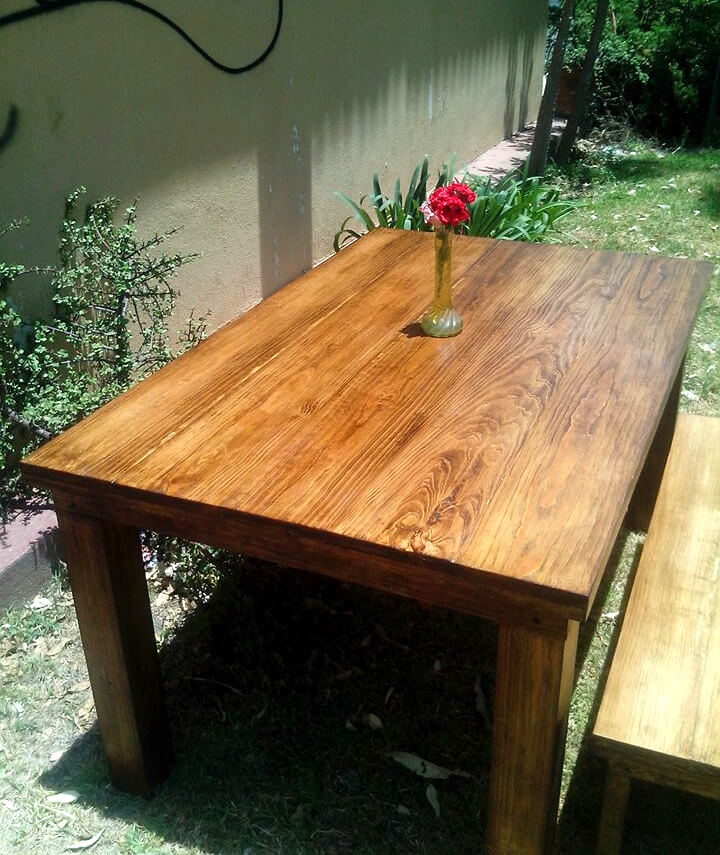 handcrafted wooden pallet table with matching bench