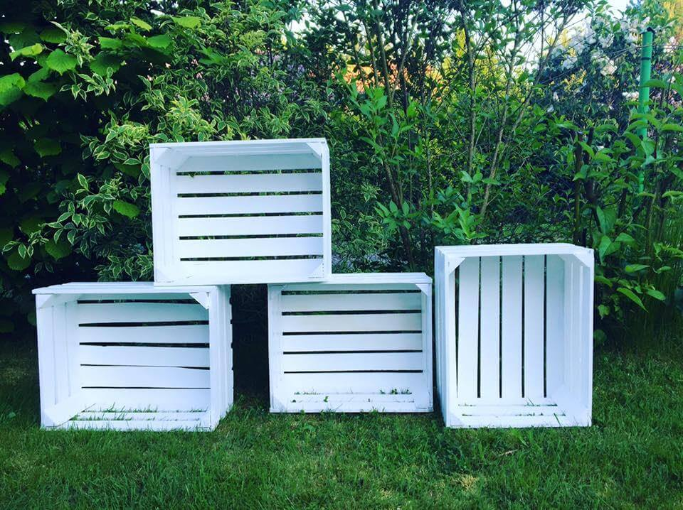 White stained pallet storage crates