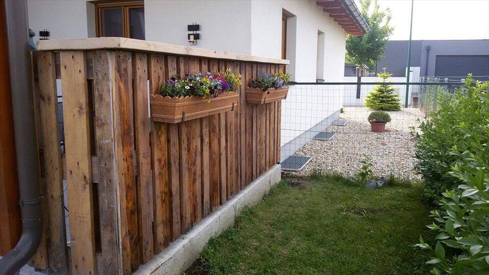 wooden pallet outdoor fence with planters