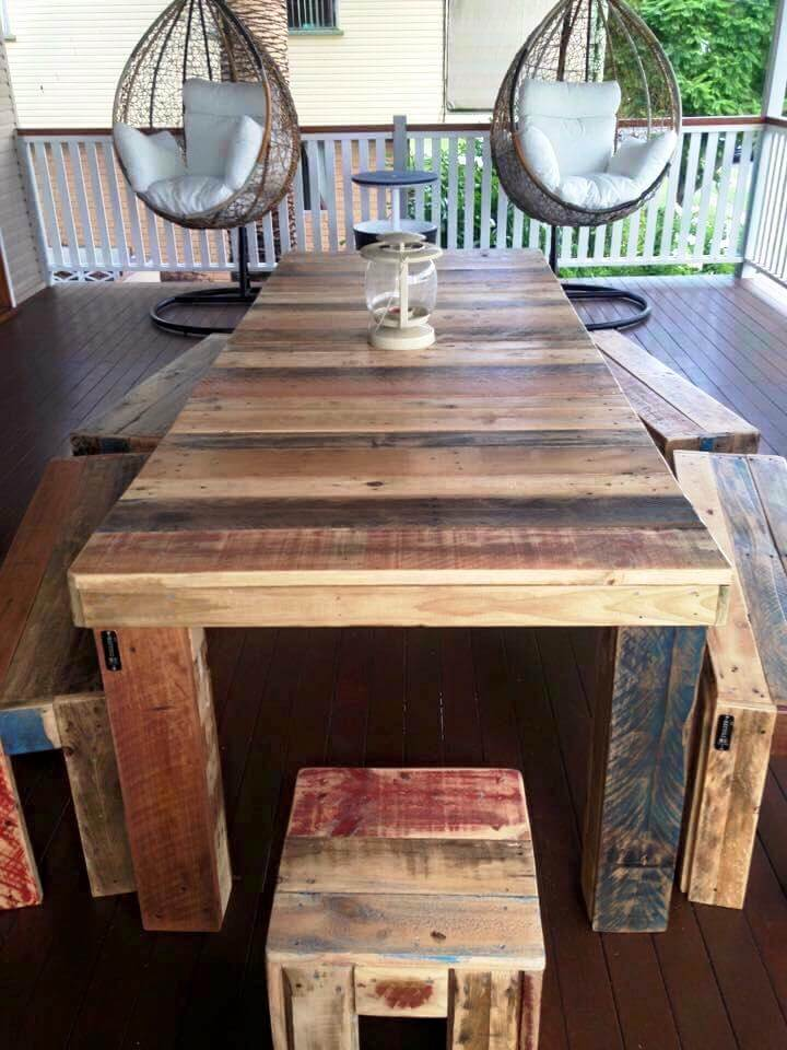 reclaimed pallet dining table with matching benches and stools