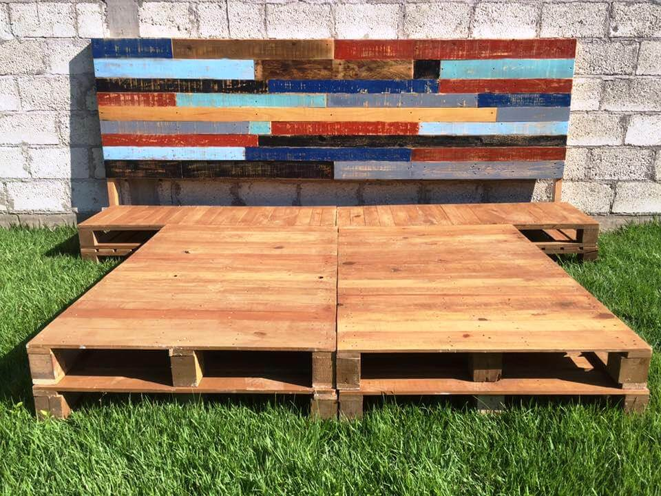 upcycled wooden pallet platform bed and headboard