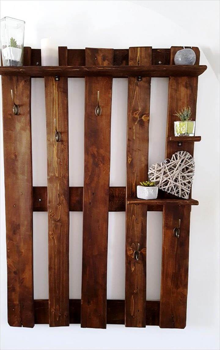 wall organizer made from pallets with hooks and shelves